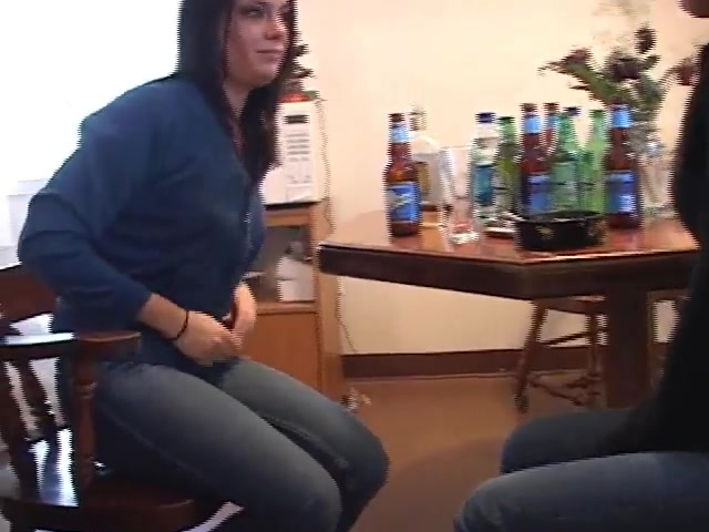 Two girls pee holding contest