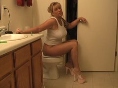 Nasty MILF farting in the toilet