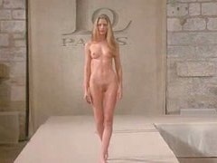 Young models walking nude on the podium