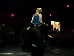Riding a bull blonde showing boobs