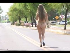 Blond girl walking totally nude and using sex toys in public