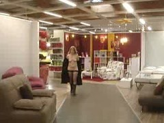 Nude mature slut walking at a furniture shop