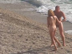 Mature couple caught fucking on the public beach