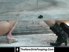 2 girls pooping