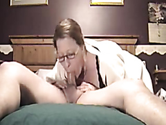 Mature lady deepthroating a huge cock