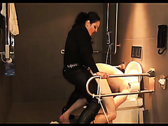 Mistress pegging her slave in the toilet
