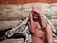 Granny rubs her tight pussy
