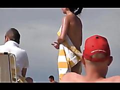 Brunette milf acting like a slut at the beach