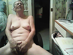 Granny fingers her shaved pussy