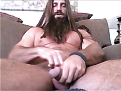 long haired and bearded muscle man solo