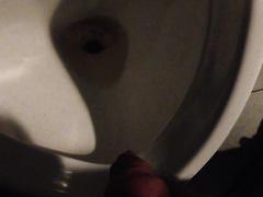 piss in urinal