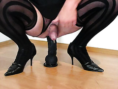 Tranny in heels pissing with huge dildo
