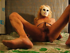 Tranny in mask shitting and cumming