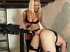 Blonde mistress has fun with a slave