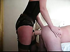Milf drills her husband with a big strap-on