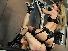 Beautiful dominatrix doing her thing