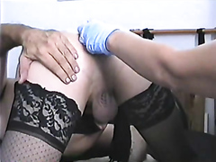 Cross dresser takes a dildo up the ass