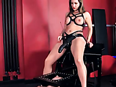 Busty dominatrix pegging a slave with a giant dildo