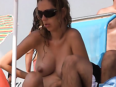 Topless pregnant girl and her friend at the beach