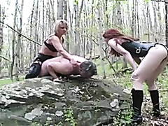 Two mistresses and a slave in the woods