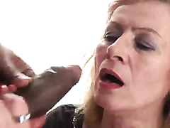 Old blonde sucking a black cock