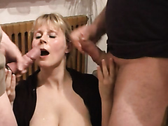 Busty blonde milf sucking two cocks