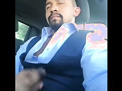 Suited jerking off in the car