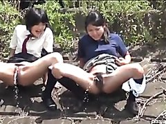 Schoolgirls pissing in a secluded spot