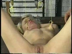 Small tits were hanging up with weights