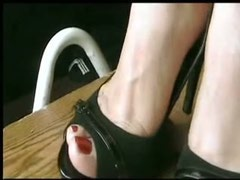 Hardcore footjob with a booted foot