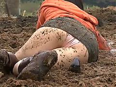 Mud wrestling girls have fun