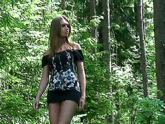 Petite blonde peeing in the forest