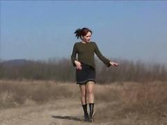 Cute model peeing in the field