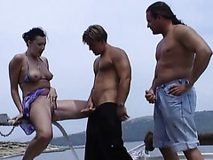 Threesome pissing on the yacht