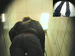Young lady filmed pissing in WC