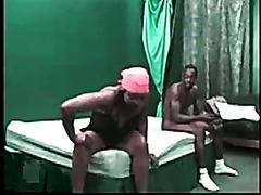 Horny ebony bitch enjoys pleasuring two massive cocks