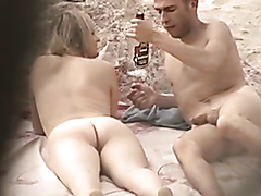 Sexy couple enjoys banging really hard on a nudist beach