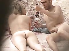 Sexy couple enjoys banging really hard on a nudist beach
