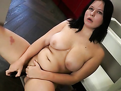 Beautiful chubby babe slides a big dildo in her wet cunt