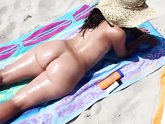 Big ass MILF naked on a beach