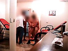 Two guys drill a milf in the gym