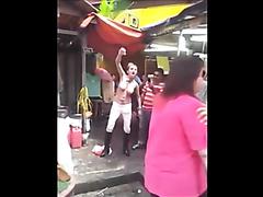 Thai hooker walks around the marketplace topless