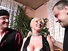 Busty mature blonde fucks two guys