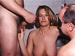 Sucking dicks and getting showered with cum