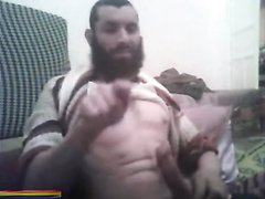 Arab bearded man masturbating