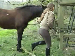 Sweetie with horse is pissing on the grass