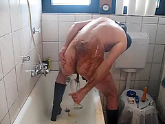 Masked guy is showering with shit
