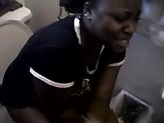 Ebony girl filmed while taking a dump