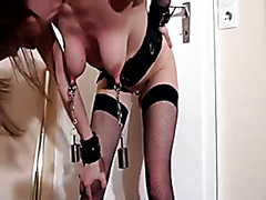 Chained slut rides a wall-mounted dildo