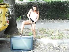Kinky babe takes a piss on a TV set